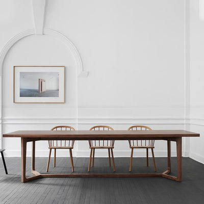 Y TABLE BY JAMES MUDGE. A clean, contemporary design, the Y Dining Table demonstrates the skill required to manufacture the complex angles and joints of its base, despite delivering a simple, utilitarian design.