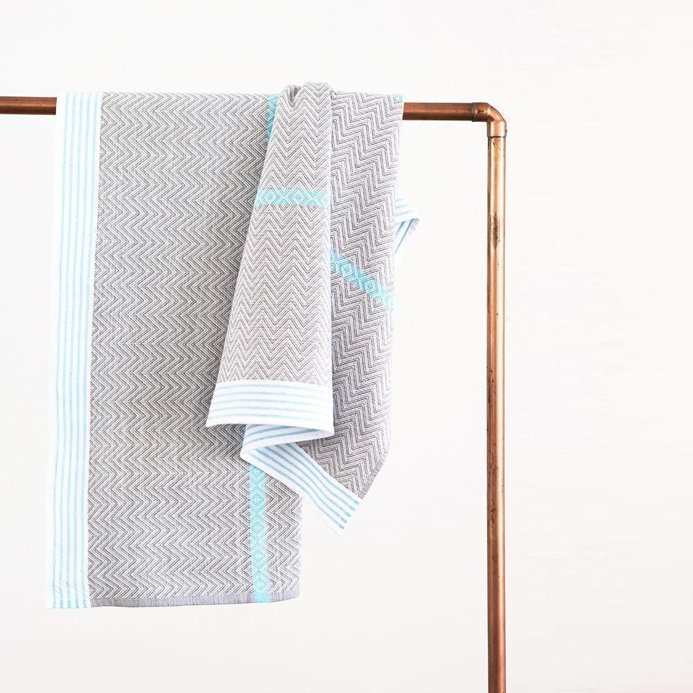 MUNGO AQUA TAWULO TOWEL By Mungo Design. This textured, monochrome range is punctuated with a few bold pops of colour in the striped details.