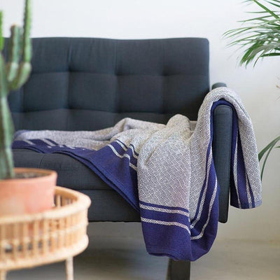 MUNGO ATLANTIC QUILL BLANKET by Mungo Design. A pure cotton full-sized blanket with an intricate cross-hatched detail and bold border. Designed and woven in South Africa.