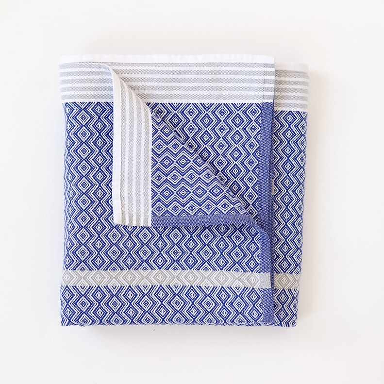 MUNGO BLUE MOON ITAWULI TOWEL by Mungo Design. This iconic towels range is loved for its bold design and versatility. The Itawuli towels are made from 100% pure cotton grown in Swaziland.
