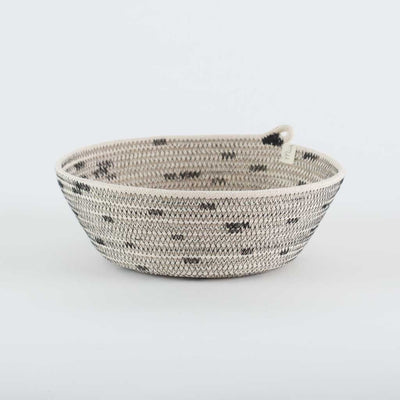 BOWL STITCHED BLACK BY MIA MELANGE HOMEWARE. These multi-purpose bowl baskets are available in three sizes. The three sizes fit together as nesting baskets. Made from 100% cotton rope.