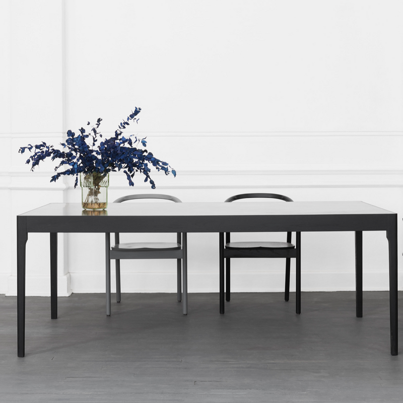 BRASS TOP DINING TABLE BY JAMES MUDGE. This dining table has a brass & solid hardwood combination. Brass provides a change whilst maintaining the material integrity of the design.