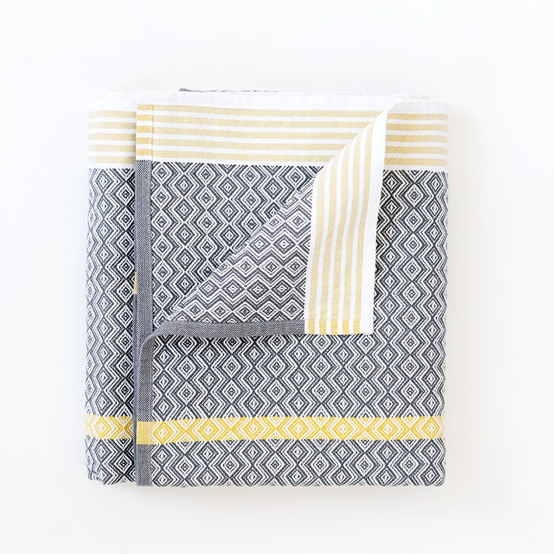 MUNGO CANGO GREY ITAWULI TOWEL by Mungo Design. This iconic towels range is loved for its bold design and versatility. The Itawuli towels are made from 100% pure cotton grown in Swaziland.