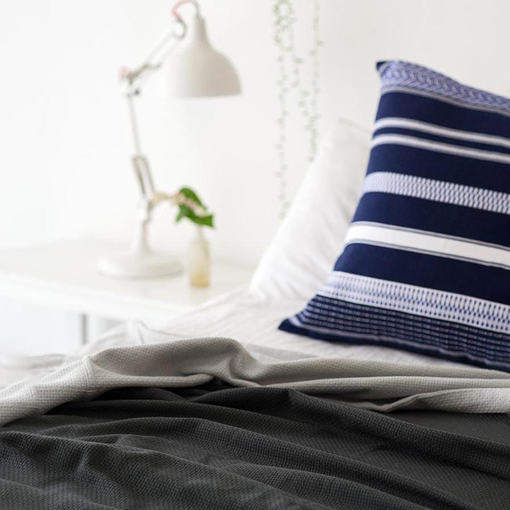 CHARCOAL INTERLACE  BED COVER by Mungo Design. Woven from pure cotton, the Interlace  is luxuriously soft and has a silky smooth texture. Perfect as a lightweight bedcover in summer or layering up in winter.