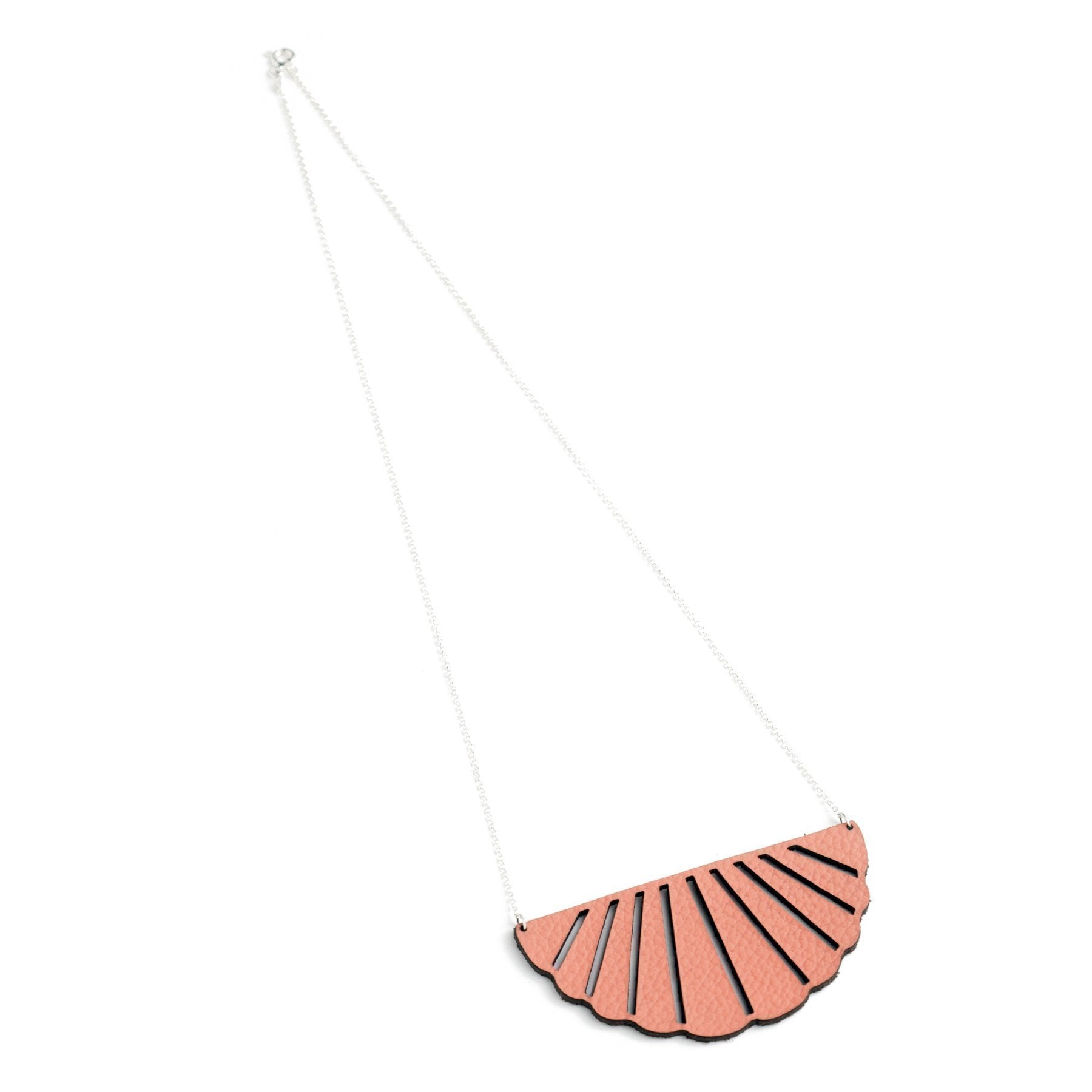 SCALLOPED LEATHER NECKLACE CORAL BY WHITE RABBIT DAYS JEWELRY. These color-popping, scalloped leather necklaces are available in a variety of colors.They hang on a sterling silver chain - perfect to peep out under a collared shirt or with a summer dress