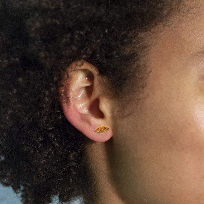 MINI EYE EARRINGS BY KIRSTEN GOSS JEWELRY. A delicate talisman of protection, these exciting mini studs made of 18kt gold vermeil can be mixed and matched.