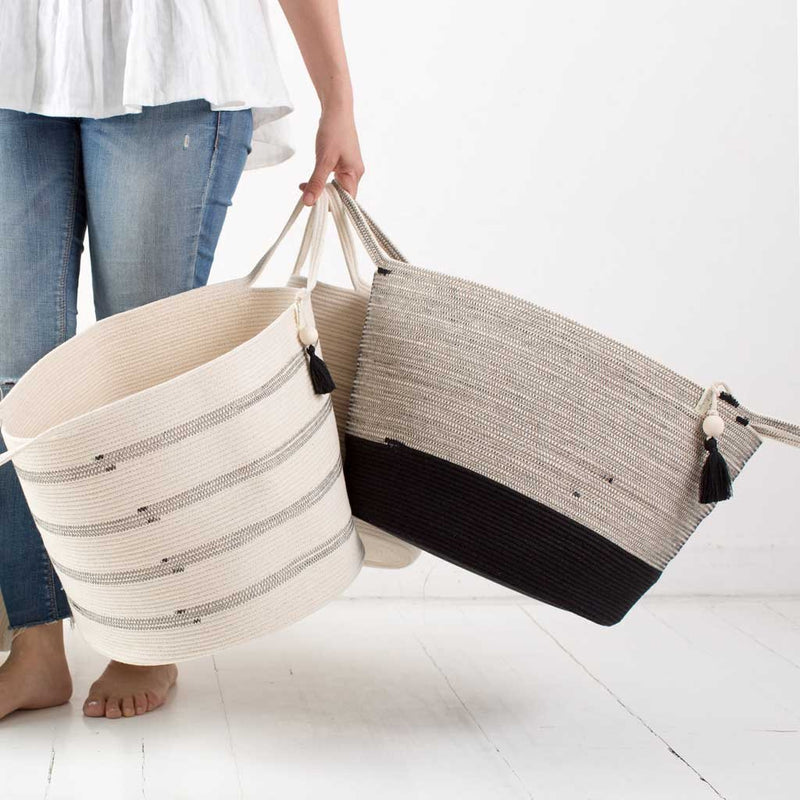 FLOOR BASKET LIQUORICE BY MIA MELANGE. These stylish floor baskets come with long handles for easy carrying. They can be used to store a variety of things: laundry, blankets, towels, throw pillows, toys etc.