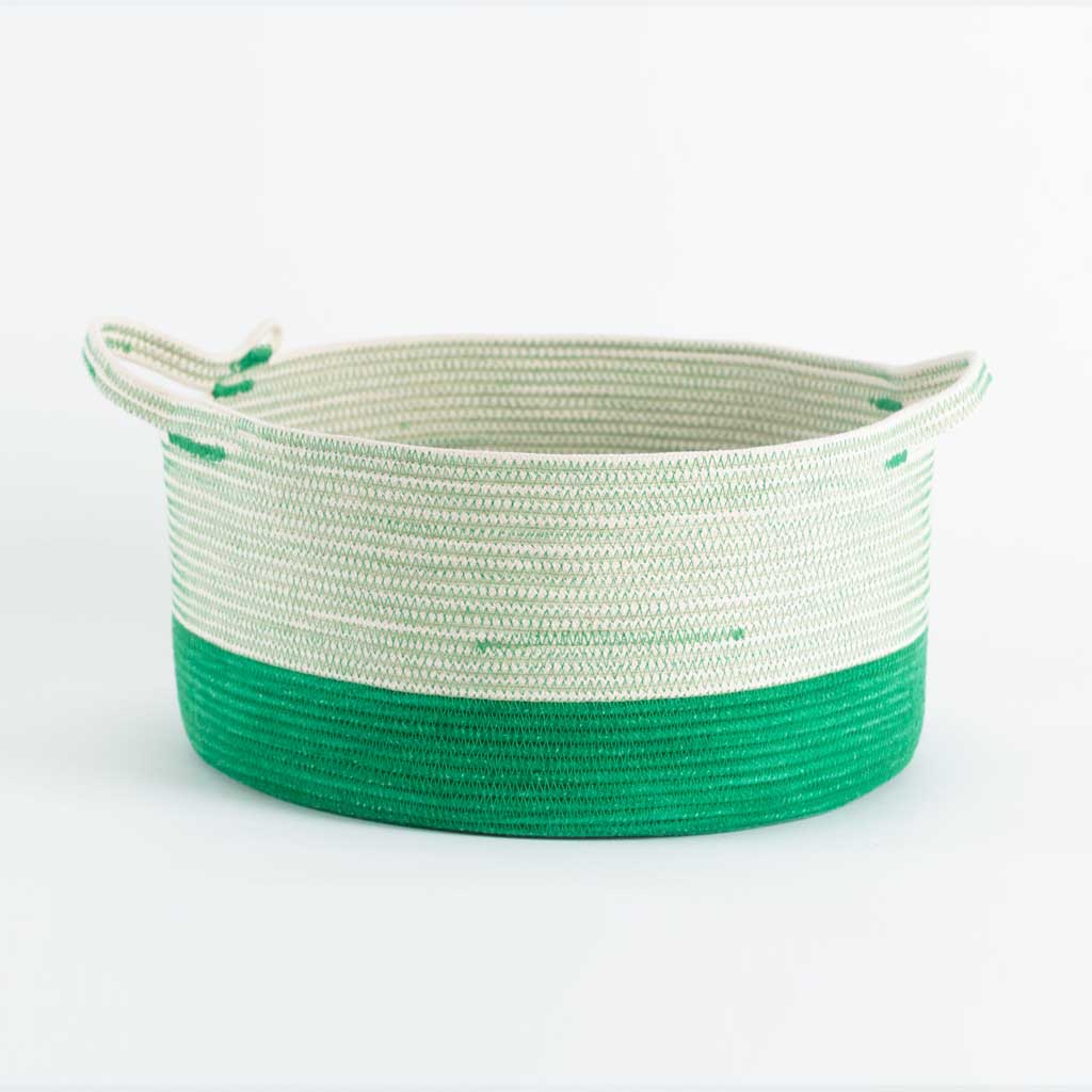 HANDLE BASKET GREENERY BY MIA MELANGE. These baskets are round and deep with handles. They are both practical and decorative and can hold just about anything. Made from 100% cotton rope.