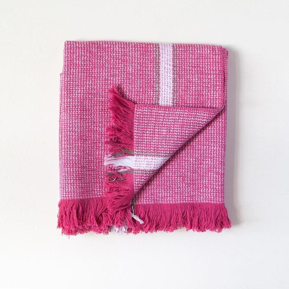 HOT PINK SUMMER TOWEL by Mungo Design. A versatile bath, pool or beach towel that is half as bulky as a standard terry towel, yet equally absorbent. Perfect to tuck neatly in a backpack, picnic basket or beach bag. Its flat weave nature comes with the added bonus of soaking up little to no sand.