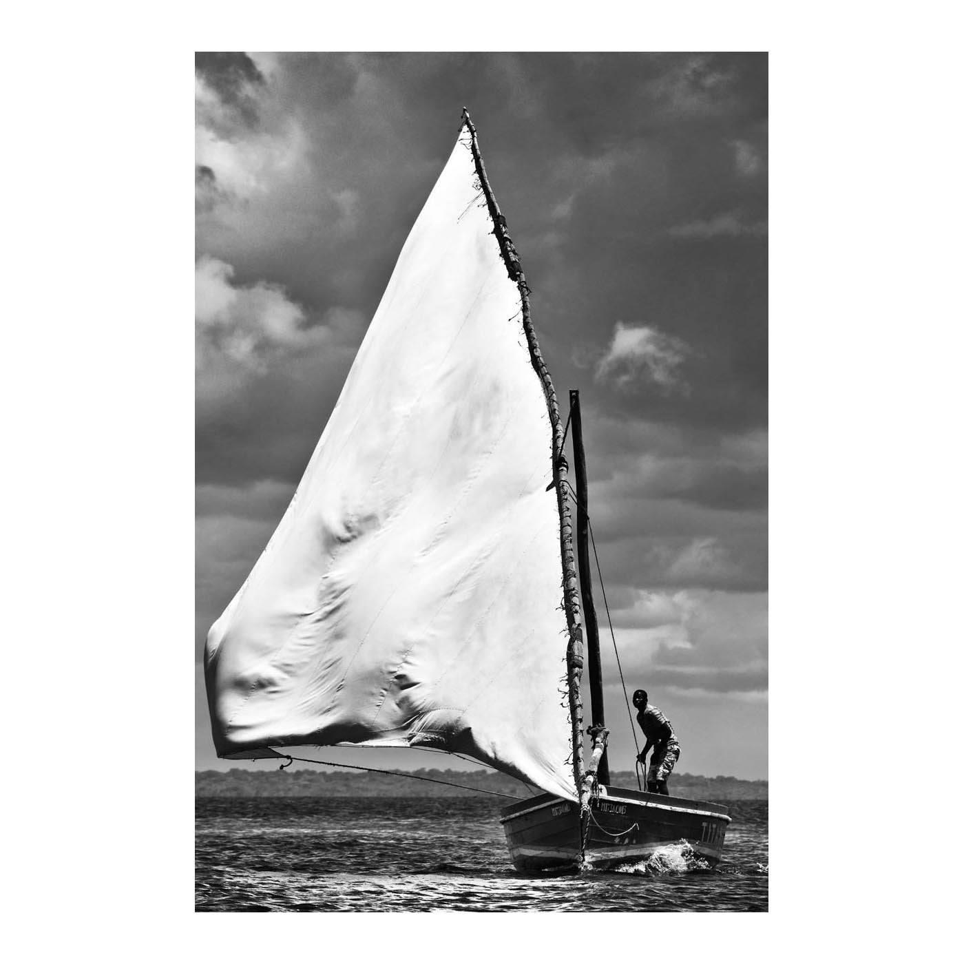 ILHA_04 BY DAVID BALLAM. Dhow VI, Ilha de Moçambique. This artwork is from the Ilha Collection by South African fine arts photographer David Ballam. It features a beautiful seascape view of fishermen at work.