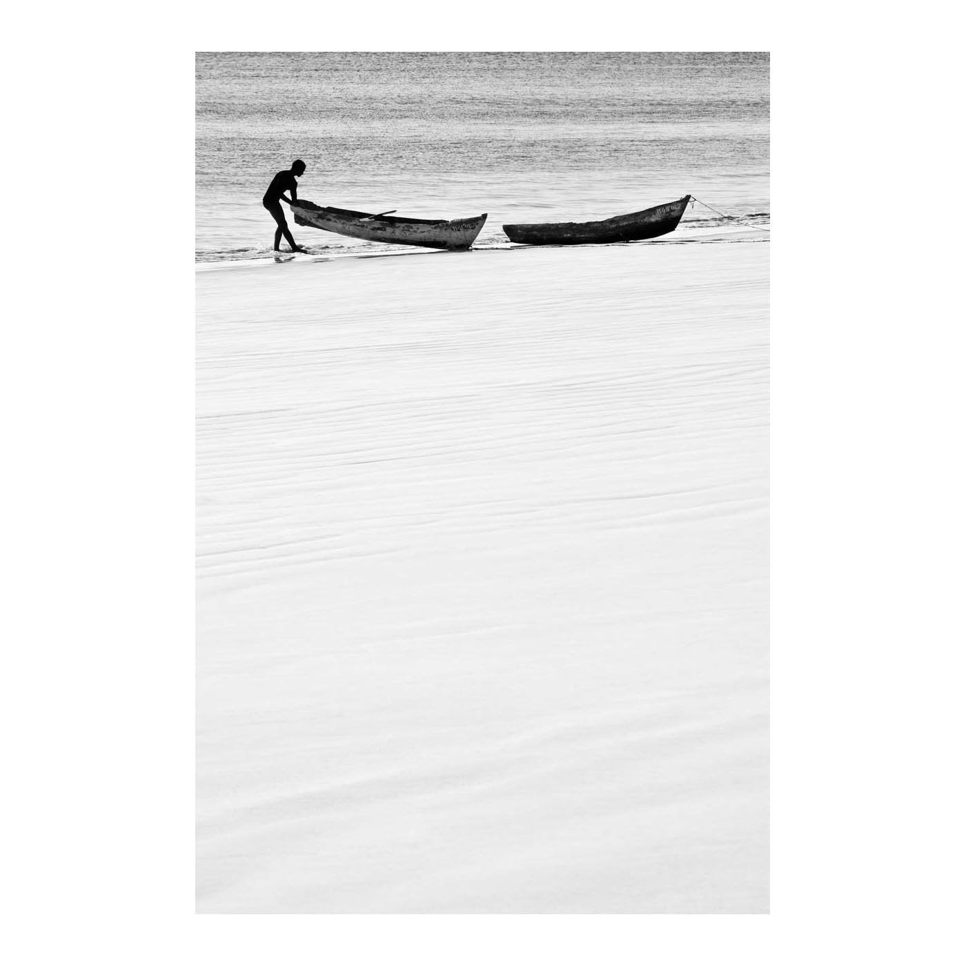 ILHA_07 BY DAVID BALLAM. Dugouts, Chocas Mar, Moçambique. This piece is from Ilha Collection by South African fine arts photographer David Ballam. It features a beautiful seascape view of fishermen at work.