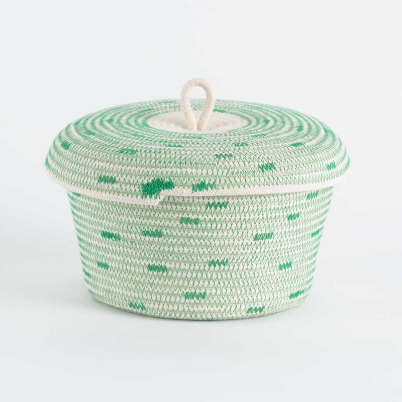 LIDDED BOWL BASKET GREENERY BY MIA MELANGE. This little lidded basket will store your odds and ends in the bathroom or on your bedside table, in style. Made from 100% cotton rope.