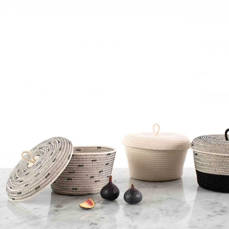 LIDDED BOWL BASKET LIQUORICE BY MIA MELANGE. This little lidded basket will store your odds and ends in the bathroom or on your bedside table, in style. Made from 100% cotton rope.