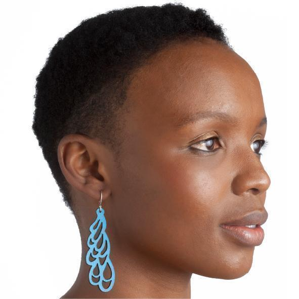 CURL LEATHER EARRINGS SKY BLUE - JEWELRY BY WHITE RABBIT DAYS. These leather earrings are laser cut and hang on Sterling Silver hooks. They are available in a variety of colors.