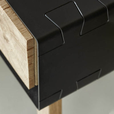 Instomi Metal Bedside Table by Meyer Von Wielligh. A modular bedside table made with cracked oak, a metal surround and pull-out drawers The Instomi Range (meaning stories in isiXhosa), tells the story of the oak tree from which it is made, with the pith of the oak tree central to the architectural silhouette of pieces found in the range.