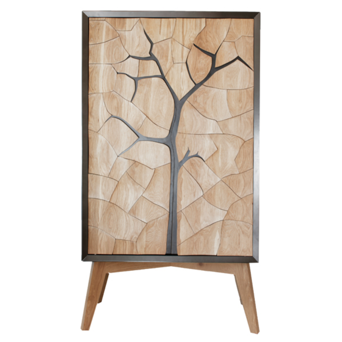 Mud Drinks Cabinet by Meyer Von Wielligh. Inspired by the cracked mud plates found on the dry riverbed of Sossusvlei in Namibia, Abrie's homeland. The metal or timber surround of the cabinet is cleverly extended into a silhouette of the branches of a tree that is also recessed handle grips for the doors.