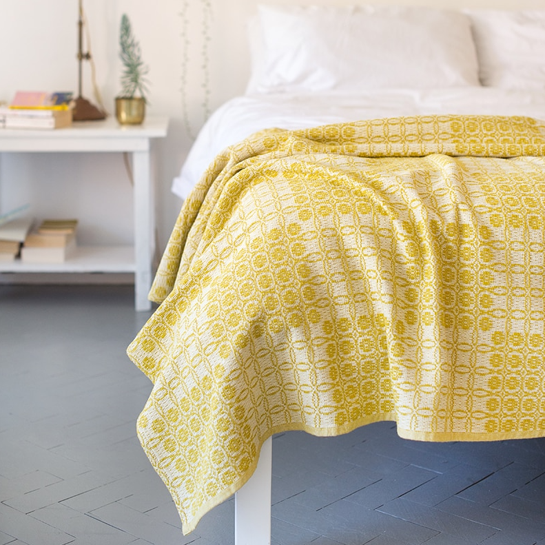 MUSTARD JUNO BLANKET by Mungo Design. A thick, robust cotton blanket, ideal for the lounge or bedroom. This weave was inspired by the traditional coverlet patterns woven in America during the 18th Century.