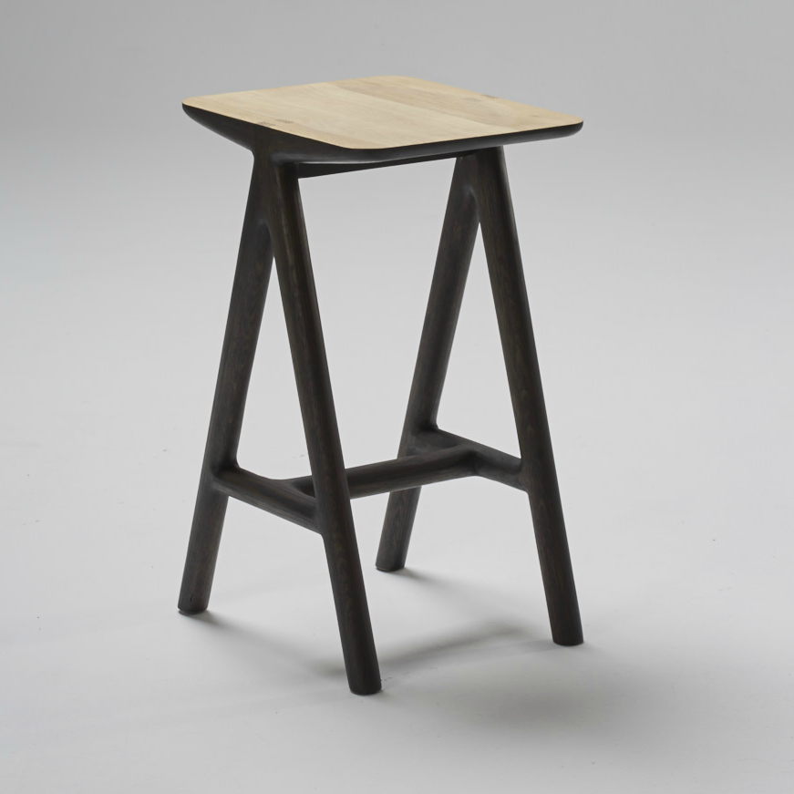 Nama Barstool by Meyer Von Wielligh. Inspired by the stark beauty of the arid Namibian landscape. Home to some of the tallest sand dunes in the world and the most solitary expanse of space, the range is an ode to uncomplicated design with every piece imbued with a simplicity in both material and detail.