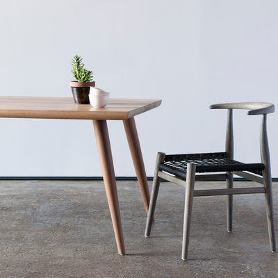 Nguni Dining Table by Vogel Design. A wooden dining table available in various timbers and finishes.