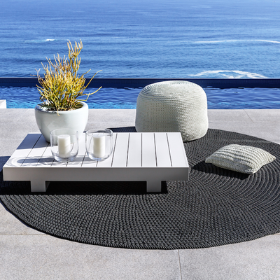 ROBALA OUTDOOR POUF BY FIBRE DESIGNS. These stylish, hand-braided outdoor poufs from The Verandah Collection are ideal for demanding domestic and commercial environments.