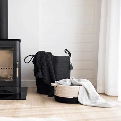 FLOOR BASKET SOLID BLACK BY MIA MELANGE. These stylish floor baskets come with long handles for easy carrying. They can be used to store a variety of things: laundry, blankets, towels, cushions, toys etc.