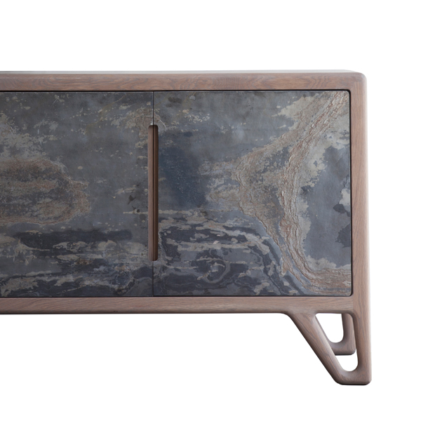 Stone Sideboard by Meyer Von Wielligh. This robust sideboard in oak with a structural leg and 4 stone veneer doors has a thin layer of stone applied to it, an imperfect pattern of rough textural stone.