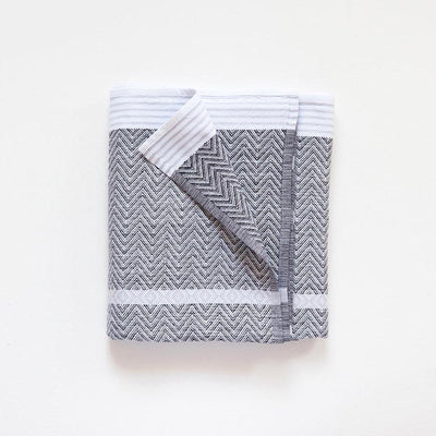 THUNDER GREY TAWULO TOWEL by Mungo Design. The Tawulo range is a classic and original addition to the Mungo flat-weave towel range. They fold up tight, ensuring they use less space and water when washing.