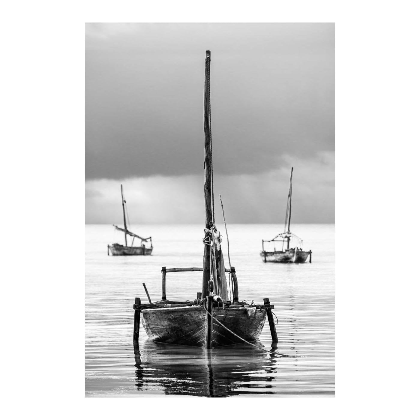 ZAN_15 BY DAVID BALLAM PHOTOGRAPHY. Dhow II, Nungwi, Zanzibar of Asante Sana Collection. A typical view of traditional outrigger boats, or Ngwalas, used by the Swahili people on the island of Zanzibar.
