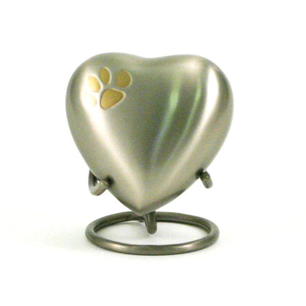 Pewter heart cremation keepsake with bronze paw print accent. 3 cubic inches. OneWorld Memorials.