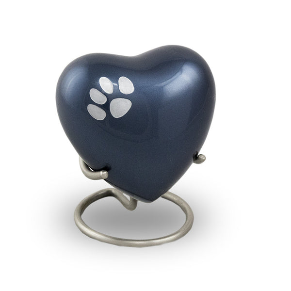 Midnight blue heart keepsake for pets with a silver paw print.