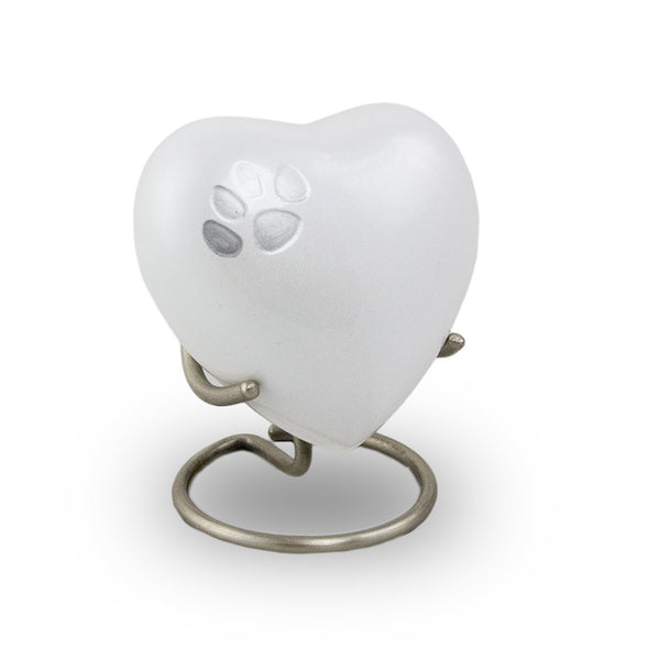 Pearl heart with pewter paw print accent. Keepsake. Holds up to 3 cubic inches.