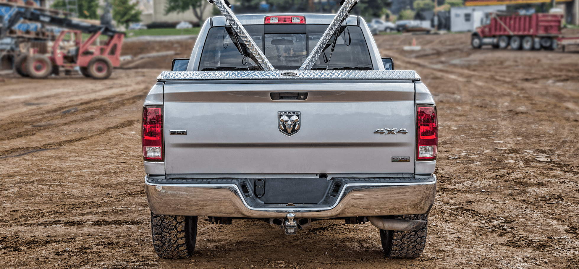 open 180 aluminum tonneau cover at construction site
