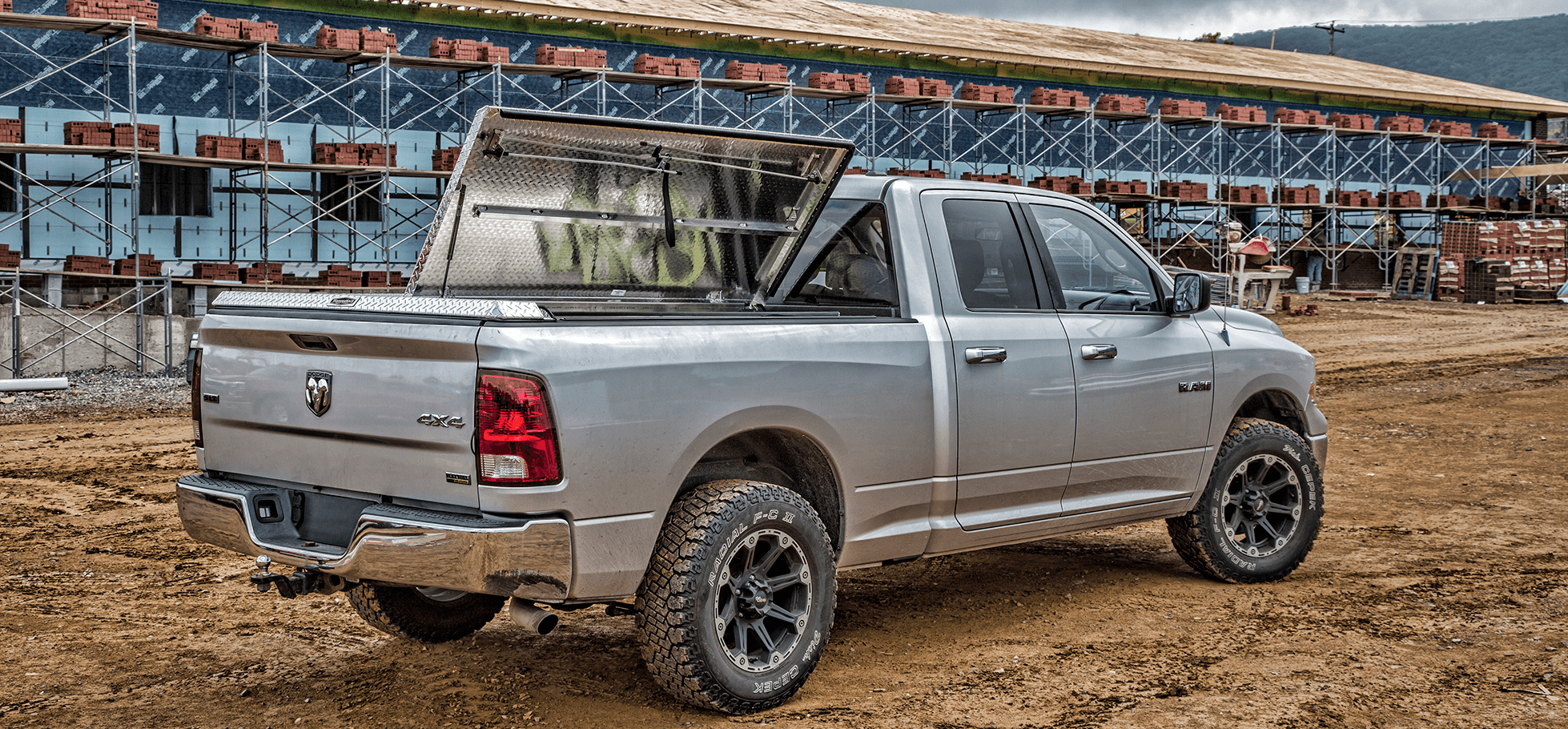 180 aluminum tonneau cover at construction site with one panel open