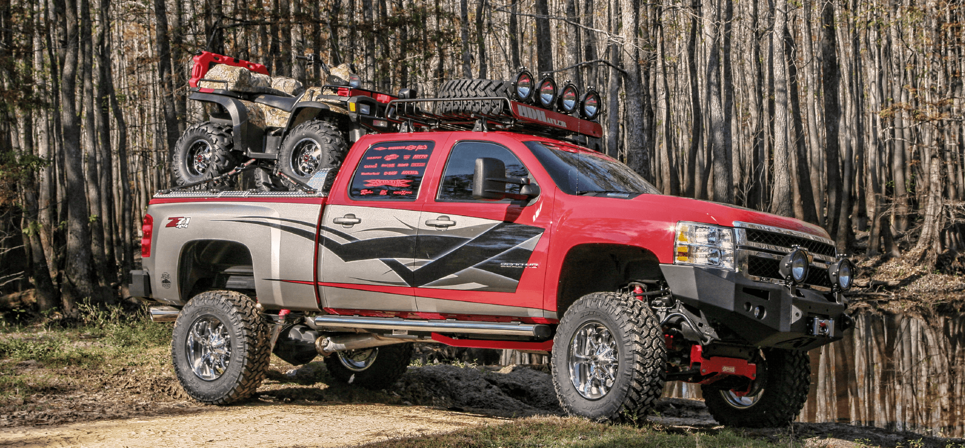 rear loading atv carrier on chevy silverado in woods
