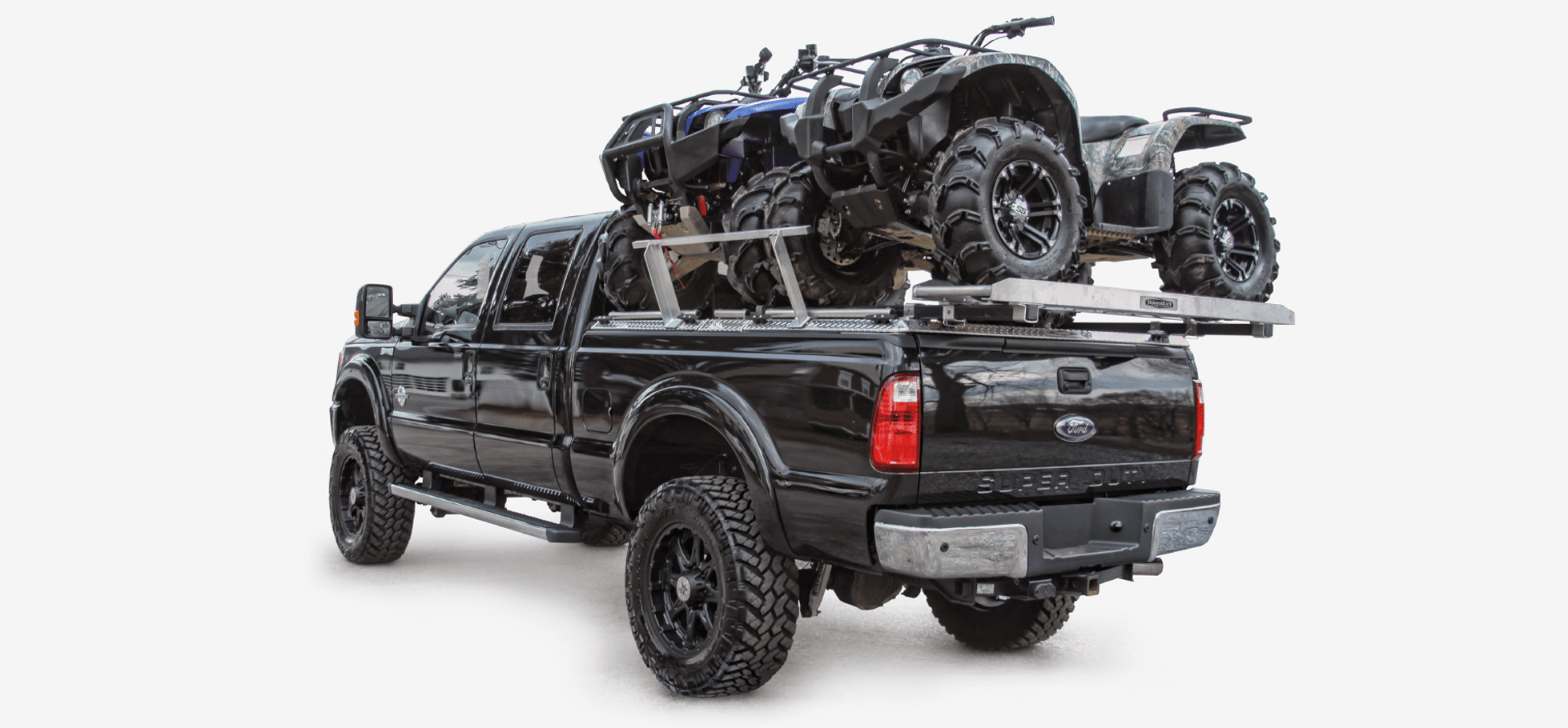 two atvs on atv truck rack on ford super duty