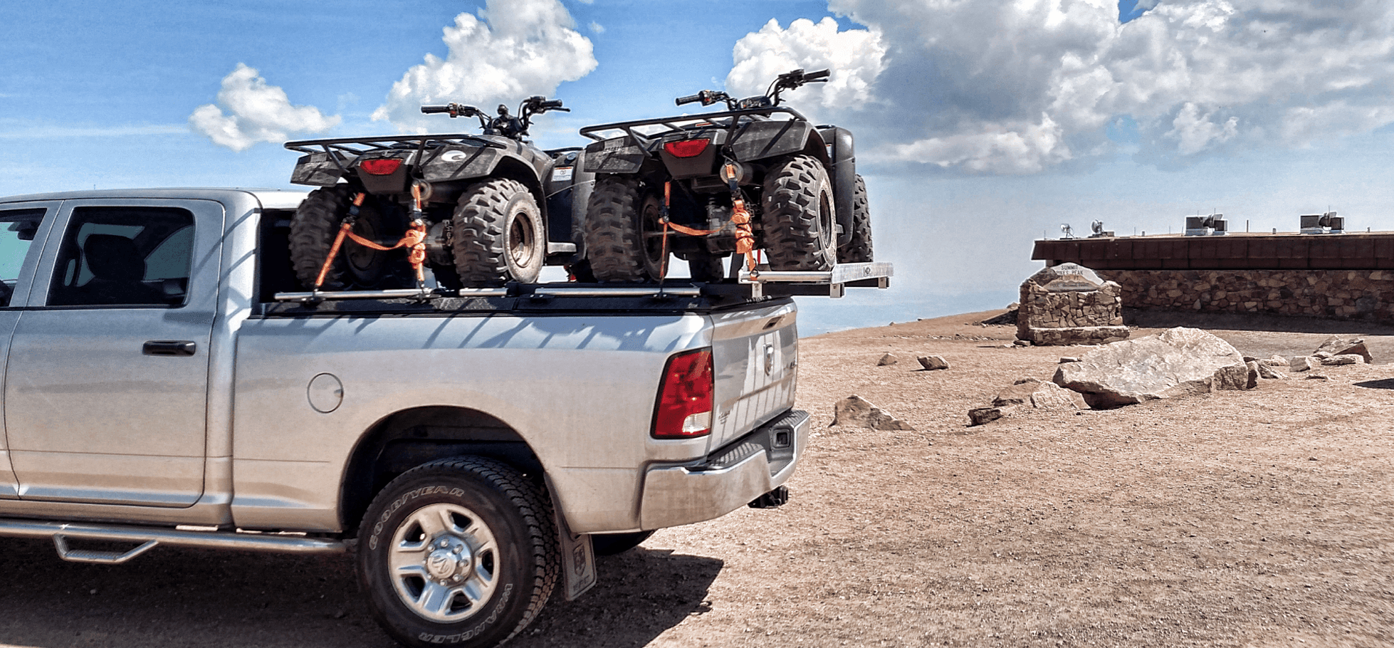 two atvs on atv truck rack on ram truck at state park