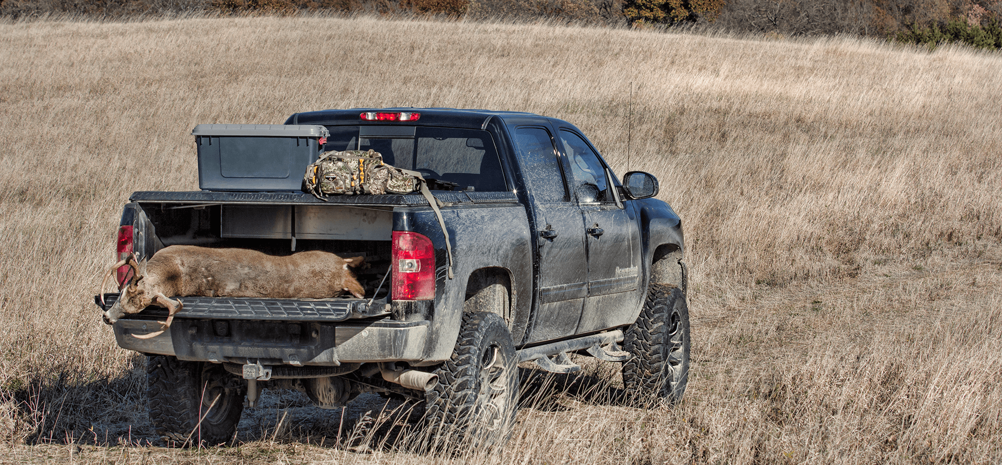 270 hard truck bed cover in fields on chevy silverado with deer