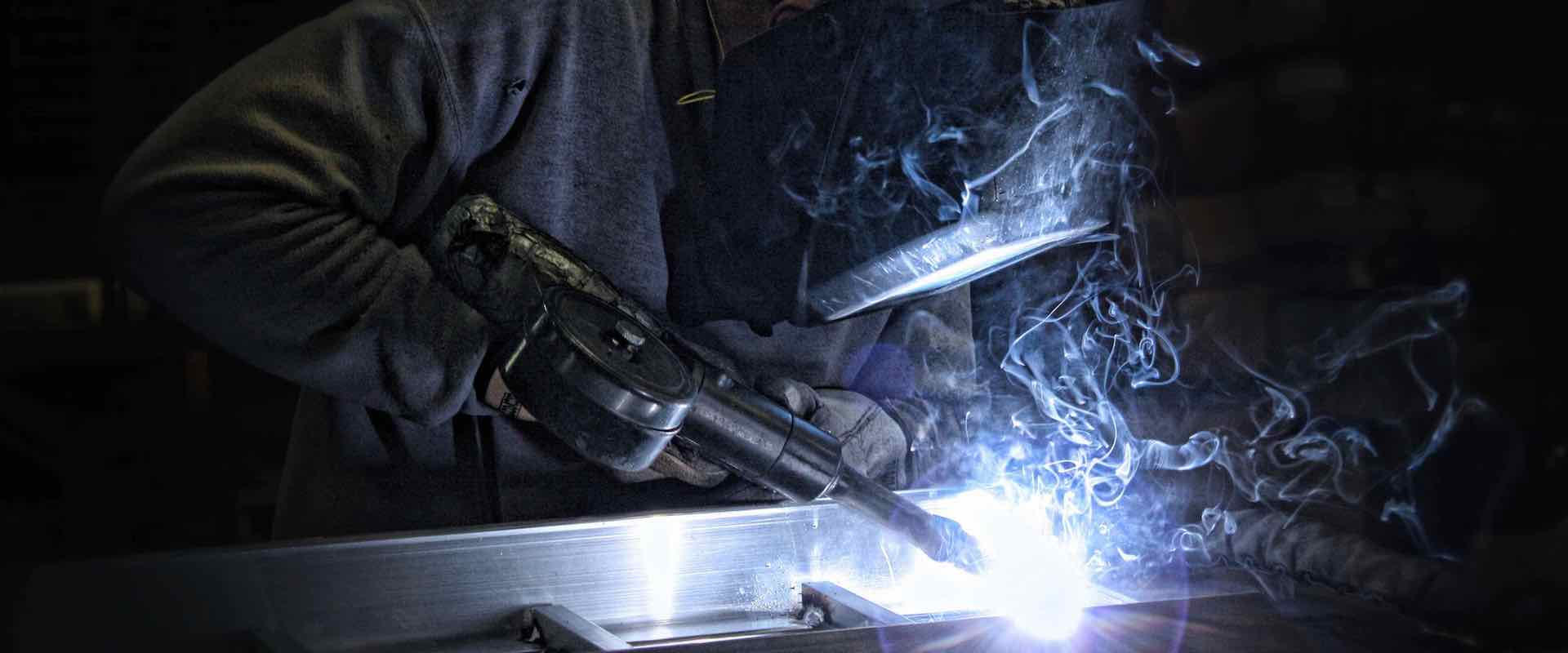 A Philipsburg man welds a DiamondBack ATV ramp