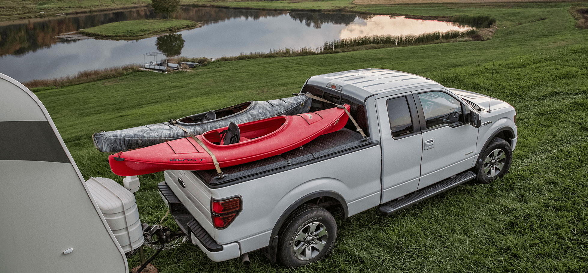 SE metal bed cover hauling two kayaks on top camping