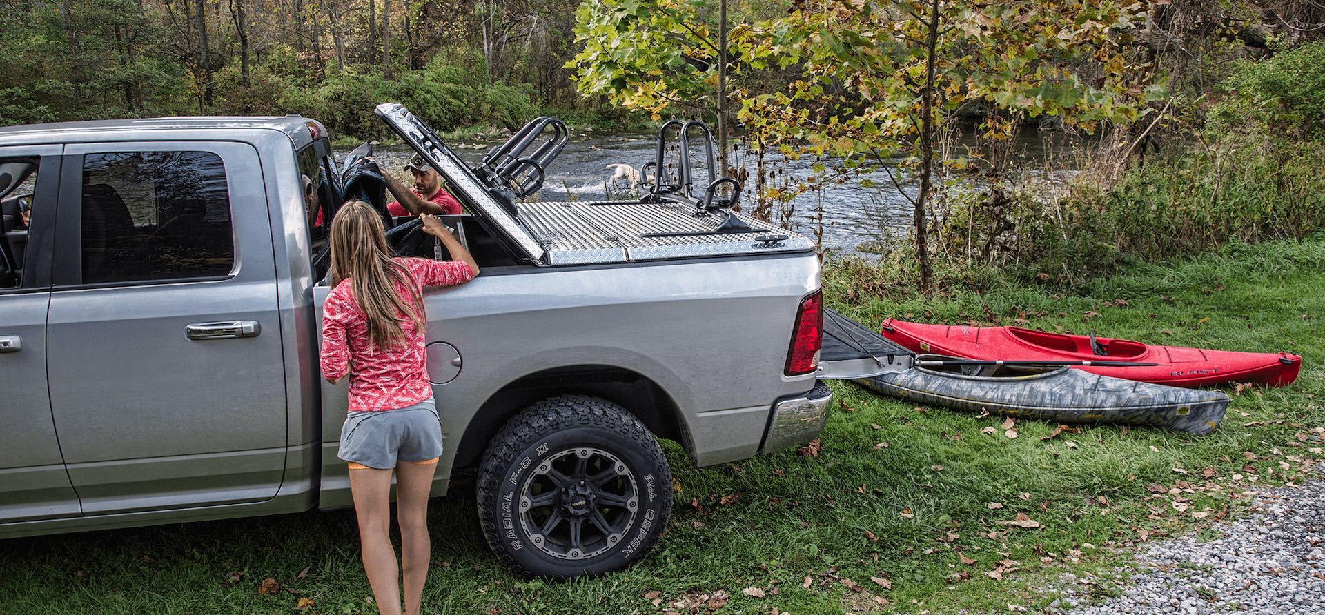 DiamondBack SE rugged metal bed cover and kayak racks on Ram pickup