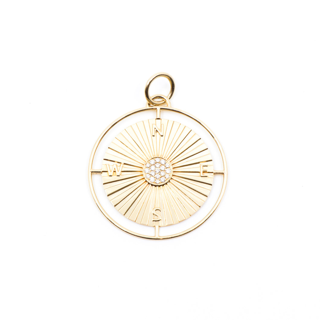 Image of a 14K gold compass pendant featuring .15 carats of pavé diamonds in the center