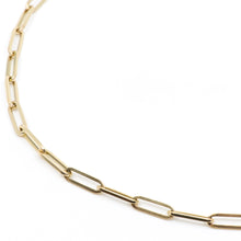 image of three paperclip chain gold necklaces in sizes large, XL, and XXL