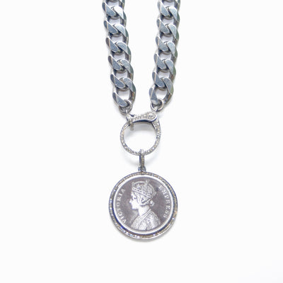Image of an authentic silver rupee coin pendant surrounded by a circle of pavé diamonds and set in sterling silver.