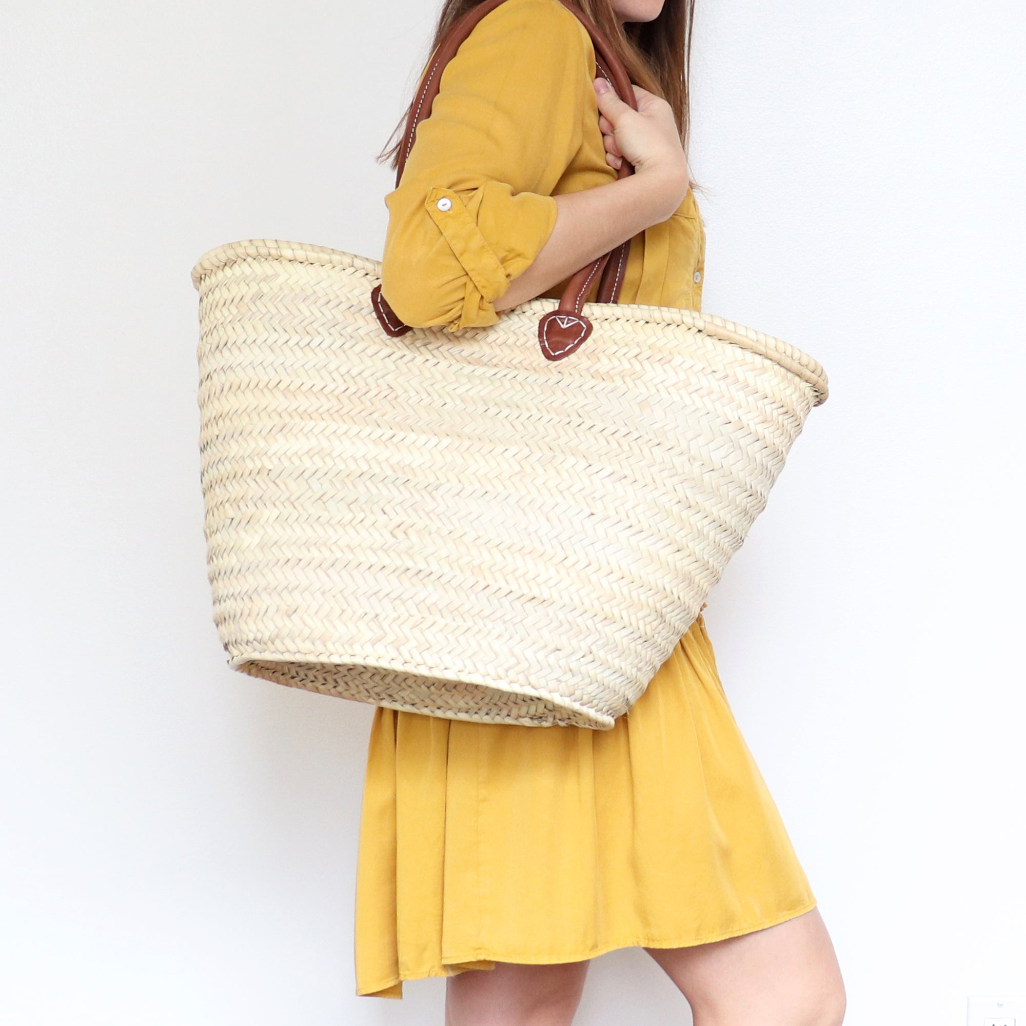 Straw bag with long leather handles