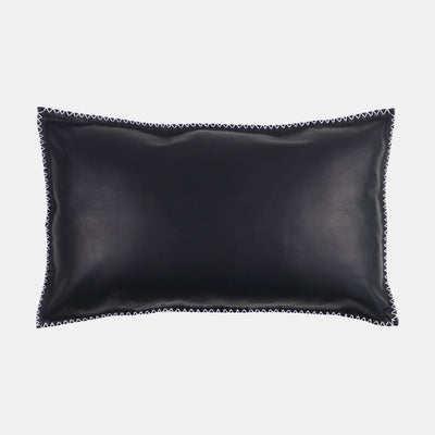 Black leather pillow with cactus fibre stitching in rectangle shape on top of a white background