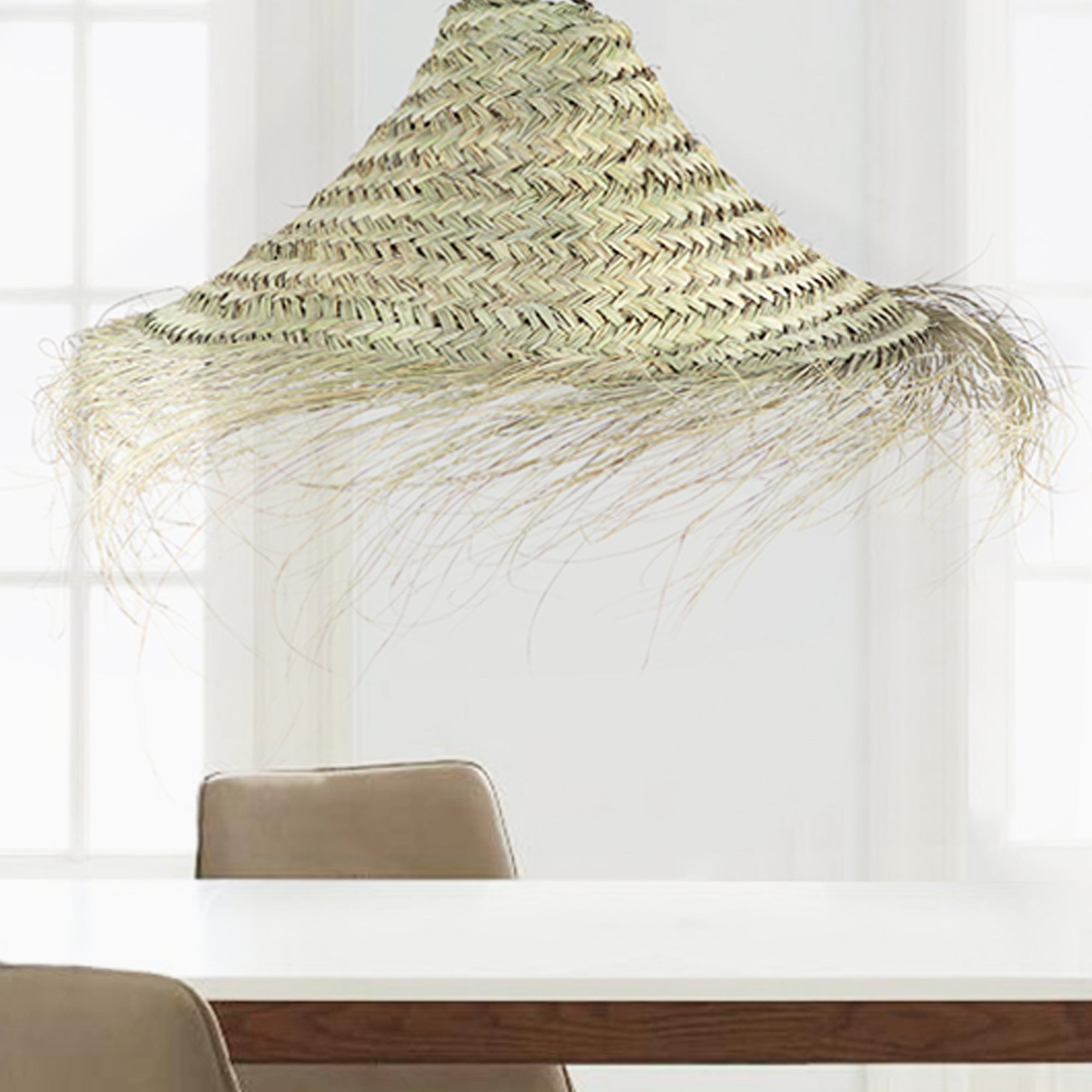 Handmade straw light pendant by artisans in Morocco