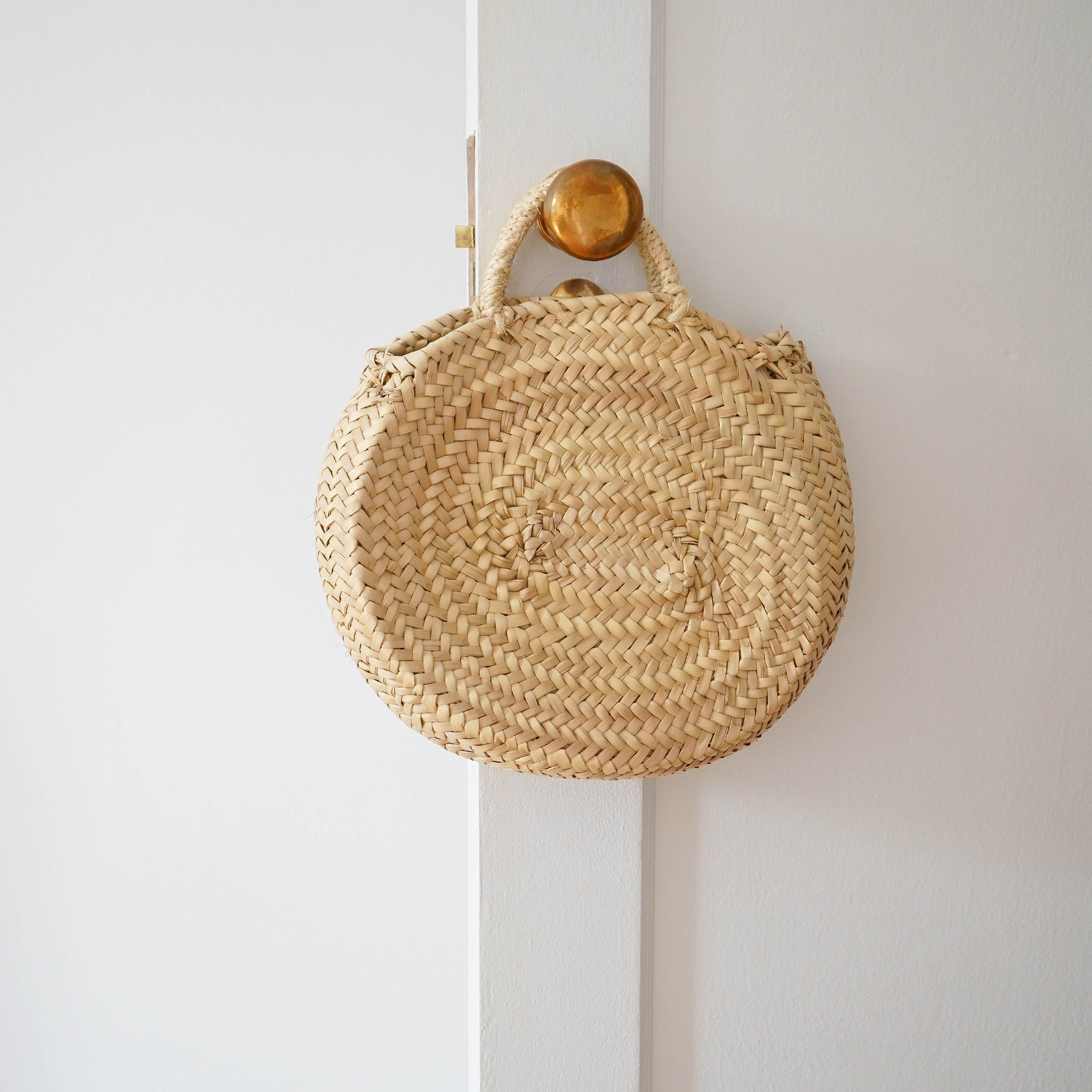 Small oval straw bag