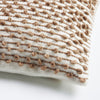 details of the texture of a camel and creme handmade wool pillow
