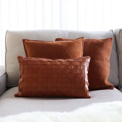Suede leather pillow in tan color with hand stitched details