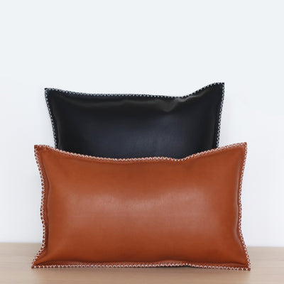 Leather pillows in back and tan color hand stitched
